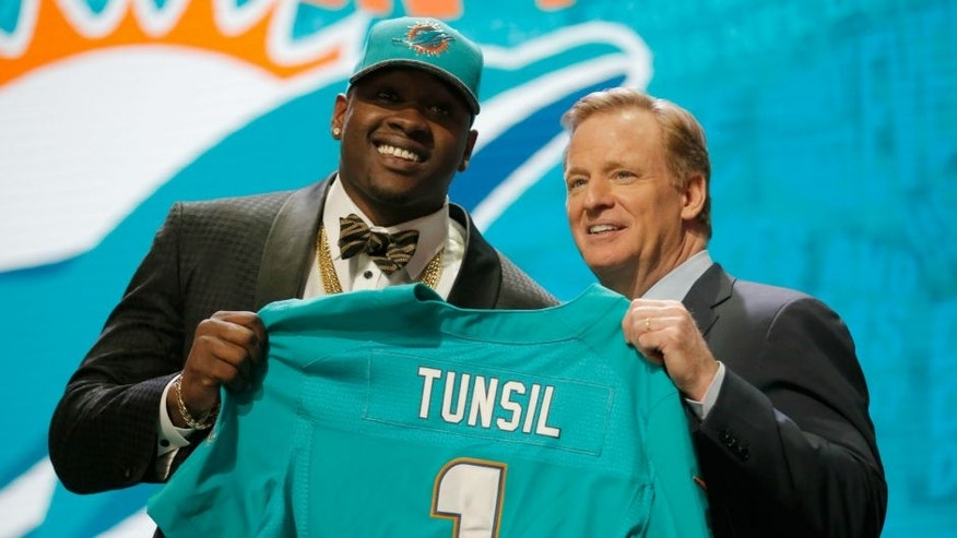 <p>during the first round of the 2016 NFL Draft at the Auditorium Theatre of Roosevelt University on April 28, 2016 in Chicago, Illinois.,CHICAGO, IL - APRIL 28: (L-R) Laremy Tunsil of Ole Miss holds up a jersey with NFL Commissioner Roger Goodell after being picked #13 overall by the Miami Dolphins during the first round of the 2016 NFL Draft at the Auditorium Theatre of Roosevelt University on April 28, 2016 in Chicago, Illinois. (Photo by Jon Durr/Getty Images)</p>