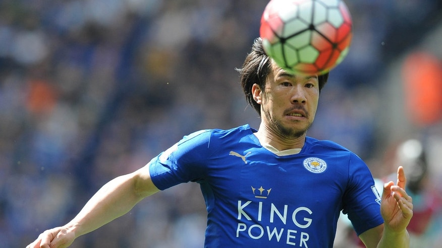 FILE - In this Sunday, April 17, 2016 file photo Leicester's Shinji Okazaki chases the ball during the English Premier League soccer match between Leicester City and West Ham United at the King Power Stadium in Leicester, England.