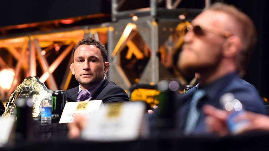 LAS VEGAS, NEVADA - SEPTEMBER 04: (L-R) Frankie Edgar looks at Conor McGregor during the UFC's Go Big launch event inside MGM Grand Garden Arena on September 4, 2015 in Las Vegas, Nevada. (Photo by Jeff Bottari/Zuffa LLC/Zuffa LLC via Getty Images)