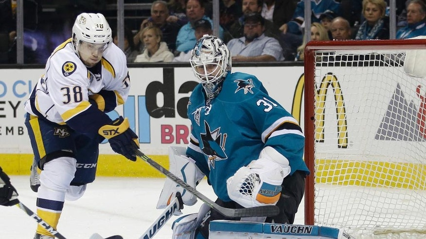 San Jose Sharks goalie Martin Jones (31) deflects a shot from Nashville Predators' Viktor Arvidsson (38) during the second period of Game 1 in an NHL hockey Stanley Cup Western Conference semifinal series Friday, April 29, 2016, in San Jose, Calif. (AP Photo/Marcio Jose Sanchez)