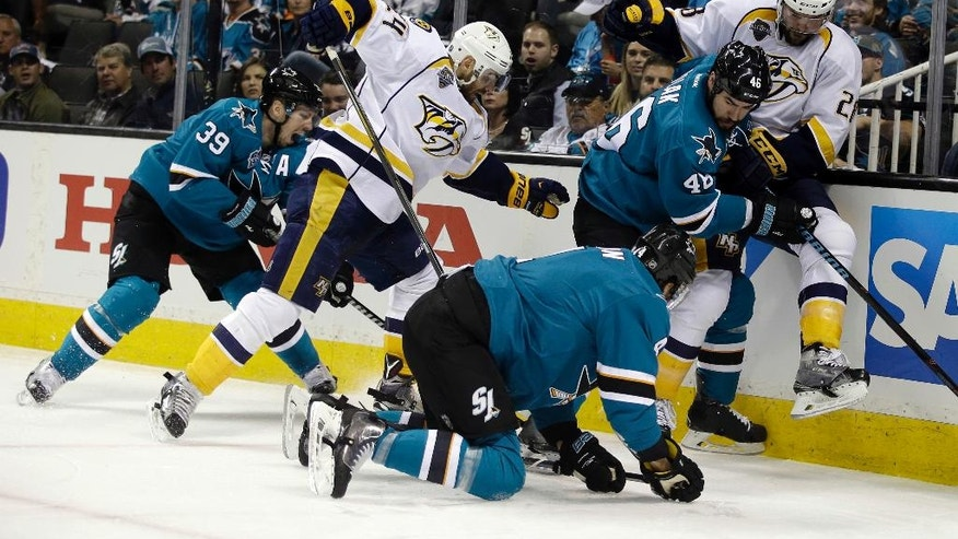 San Jose Sharks and Nashville Predators battle near the boards during the second period of Game 1 in an NHL hockey Stanley Cup Western Conference semifinal series Friday, April 29, 2016, in San Jose, Calif. (AP Photo/Marcio Jose Sanchez)