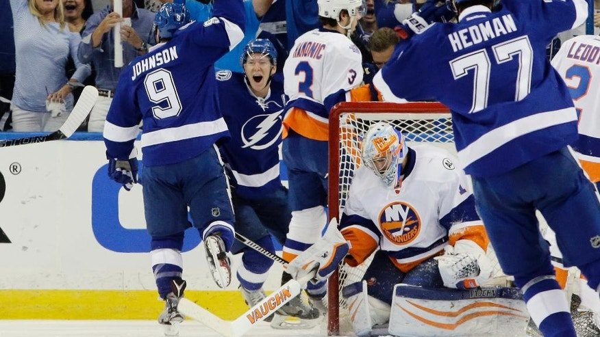 Tampa Bay Lightning center Tyler Johnson (9) raises his hand after scoring a goal during the first  period of Game 2 of the NHL hockey Stanley Cup Eastern Conference semifinals against the New York Islanders, Saturday, April 30, 2016, in Tampa, Fla. (AP Photo/Chris O'Meara)