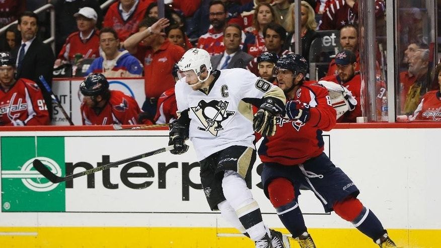 Washington Capitals left wing Alex Ovechkin, right, goes up against Pittsburgh Penguins center Sidney Crosby, left, during the second period of Game 1 in an NHL hockey Stanley Cup Eastern Conference semifinals Thursday, April 28, 2016 in Washington. (AP Photo/Pablo Martinez Monsivais)