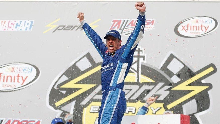 NASCAR Xfinity driver Elliott Sadler, (1) celebrates after winning the NASCAR Xfinity Series auto race at Talladega Superspeedway, Saturday, April 30, 2016, in Talladega, Ala. (AP Photo/Brynn Anderson)