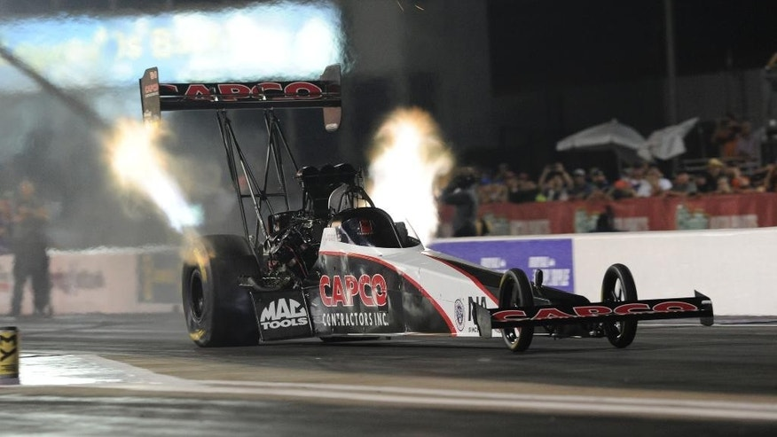 In this photo provided by NHRA, Steve Torrence powers his Capco Contractors/Torrence Racing dragster to the qualifying lead on Friday, April 29, 2016, at the NHRA SpringNationals at Royal Purple Raceway in Baytown, Texas. Torrence, set the track E.T. record with 3.724 second run at 329.42 mph during the second round of qualifying at the sixth NHRA Mello Yello Drag Racing Series event of the season. Torrence will be racing for his third consecutive No. 1 qualifier during Saturday's final two rounds of qualifying. (Jerry Foss/NHRA via AP)