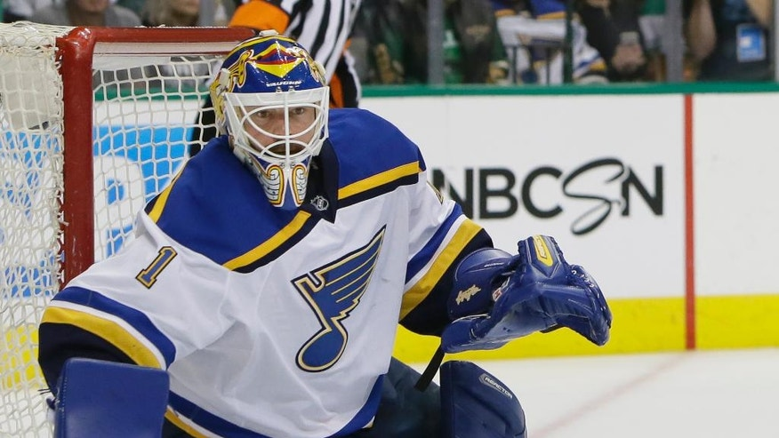St. Louis Blues goalie Brian Elliott (1) watches the puck during the first period of Game 2 of the NHL hockey Stanley Cup Western Conference semifinals against the Dallas Stars, Sunday, May 1, 2016, in Dallas. (AP Photo/LM Otero)