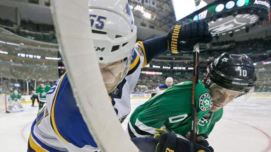 St. Louis Blues defenseman Colton Parayko (55) and Dallas Stars left wing Patrick Sharp (10) tangle during the second period of Game 2 of the NHL hockey Stanley Cup Western Conference semifinals, Sunday, May 1, 2016, in Dallas. (AP Photo/LM Otero)