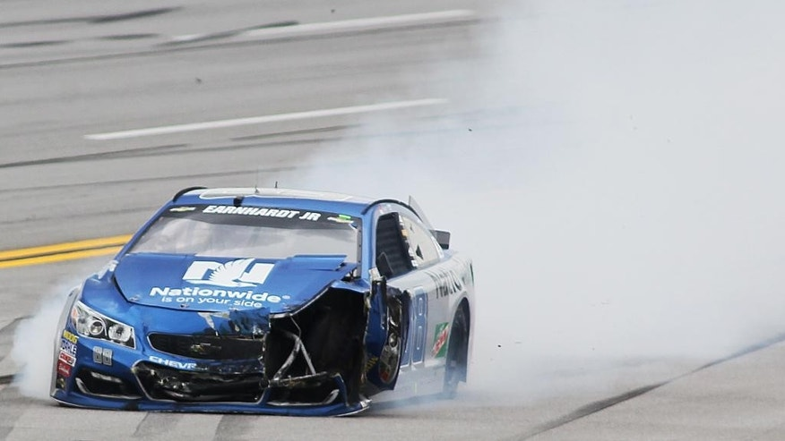 CORRECTS PHOTOGRAPHERS LAST NAME TO MCWILLIAMS- Dale Earnhardt Jr. wrecks near Turn 2 during the NASCAR Talladega auto race at Talladega Superspeedway, Sunday, May 1, 2016, in Talladega, Ala. (AP Photo/Greg McWilliams)