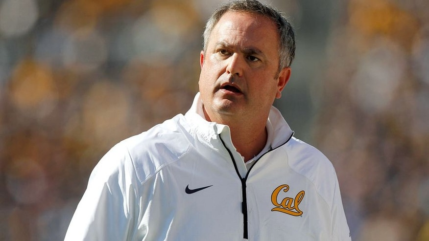 Oct 18, 2014; Berkeley, CA, USA; California Golden Bears head coach Sonny Dykes reacts after the Golden Bears were penalized against the UCLA Bruins the third quarter at Memorial Stadium. The Bruins won 36-34. Mandatory Credit: Cary Edmondson-USA TODAY Sports