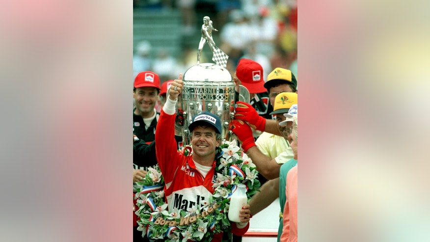 FILE = In this May 26, 1991 file phto, Rick Mears celebrates with the traditional bottle of milk after winning the 75th running of the Indy 500 on May 26, 1991. (AP Photo/Mark Duncan, File)