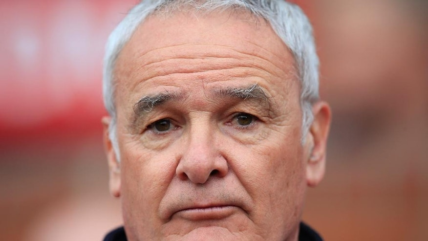 Leicester's manager Claudio Ranieri takes to the touchline before the English Premier League soccer match between Manchester United and Leicester at Old Trafford Stadium, Manchester, England, Sunday, May 1, 2016. (AP Photo/Jon Super)