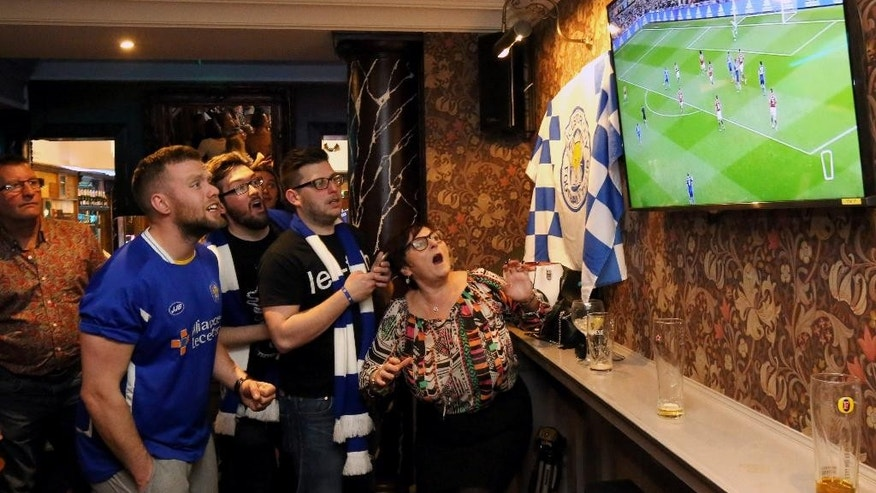 Leicester City soccer fans watch the game between Manchester United and Leicester City, shown live on TV at Hogarts bar in Leicester, England,  Sunday May 1, 2016. (Chris Radburn / PA via AP) UNITED KINGDOM OUT - NO SALES - NO ARCHIVES