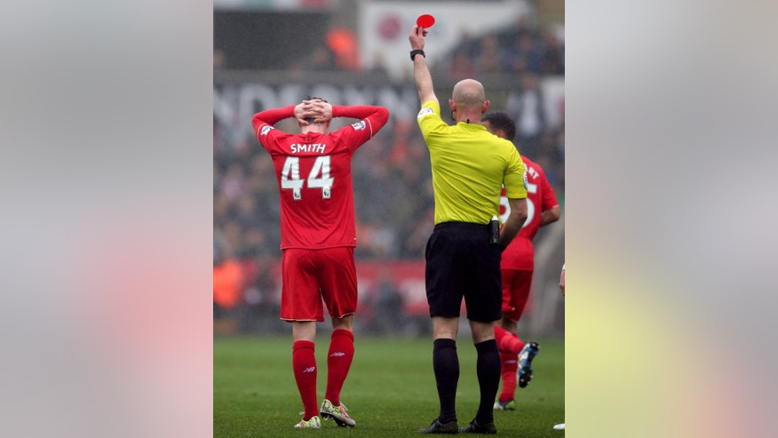 Liverpool's Brad Smith is shown a red card by referee Roger East, during the English Premier League soccer match between Swansea City and Liverpool,  at the Liberty Stadium, in Swansea, Wales,  Sunday May 1, 2016. (David Davies/PA via AP) UNITED KINGDOM OUT