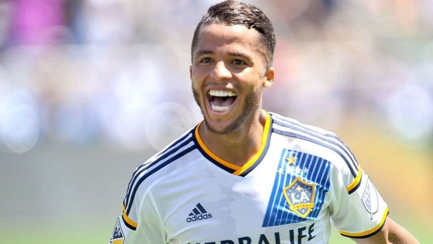 August 23, 2015; Carson, CA, USA; Los Angeles Galaxy midfielder/forward Giovani Dos Santos (10) celebrates his goal scored against New York City FC during the second half at StubHub Center. Mandatory Credit: Gary A. Vasquez-USA TODAY Sports