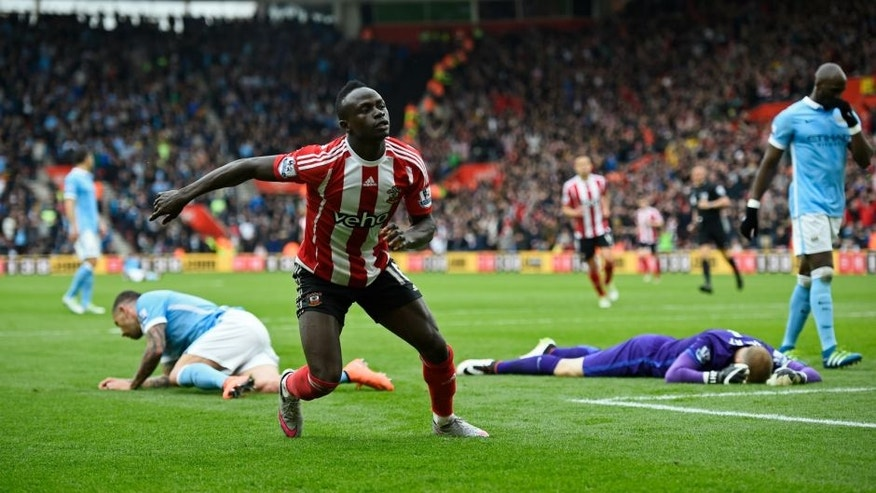 "Britain Football Soccer - Southampton v Manchester City - Barclays Premier League - St Mary's Stadium - 1/5/16 Sadio Mane celebrates after scoring the the fourth goal for Southampton and completing his hat trick Reuters / Dylan Martinez Livepic EDITORIAL USE ONLY. No use with unauthorized audio, video, data, fixture lists, club/league logos or ""live"" services. Online in-match use limited to 45 images, no video emulation. No use in betting, games or single club/league/player publications. Please contact your account representative for further details."