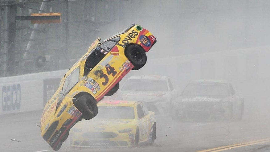 CORRECTS PHOTOGRAPHERS LAST NAME TO MCWILLIAMS- Chris Buescher (34) wrecks during the NASCAR Talladega auto race at Talladega Superspeedway, Sunday, May 1, 2016, in Talladega, Ala. (AP Photo/Greg McWilliams)