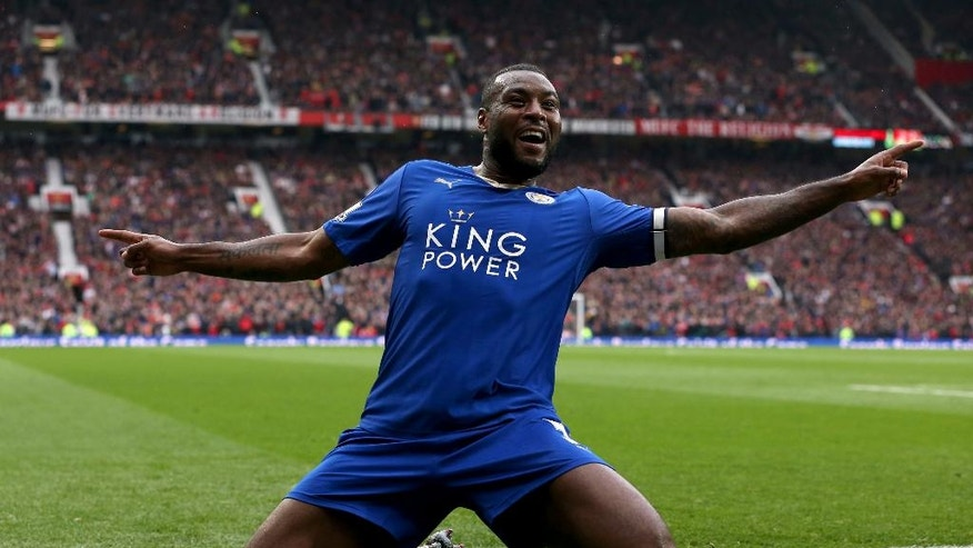 Leicester City's Wes Morgan celebrates scoring his side's first goal of the game, during the English Premier League soccer match between Manchester United and Leicester City, at Old Trafford, in Manchester, England, Sunday May 1, 2016. (Martin Rickett/PA via AP) UNITED KINGDOM OUT