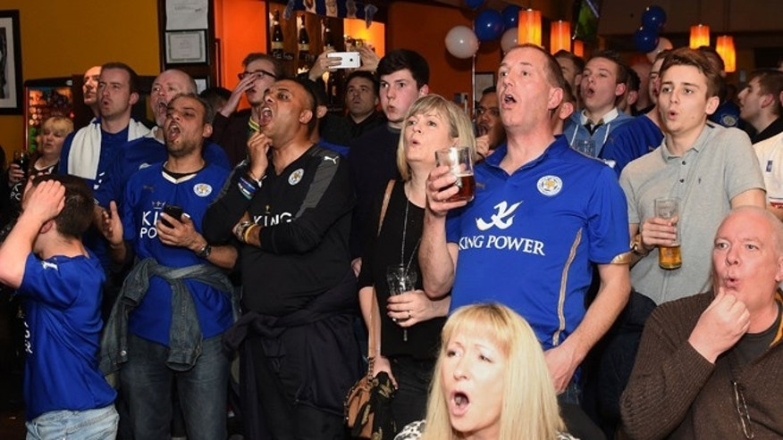 Leicester City fans react as they watch the Chelsea versus Tottenham Hotspur English Premier League soccer match at the Local Hero public house in Leicester, central England, Monday May 2, 2016. (Joe Giddens/PA via AP) UNITED KINGDOM OUT  NO SALES NO ARCHIVE