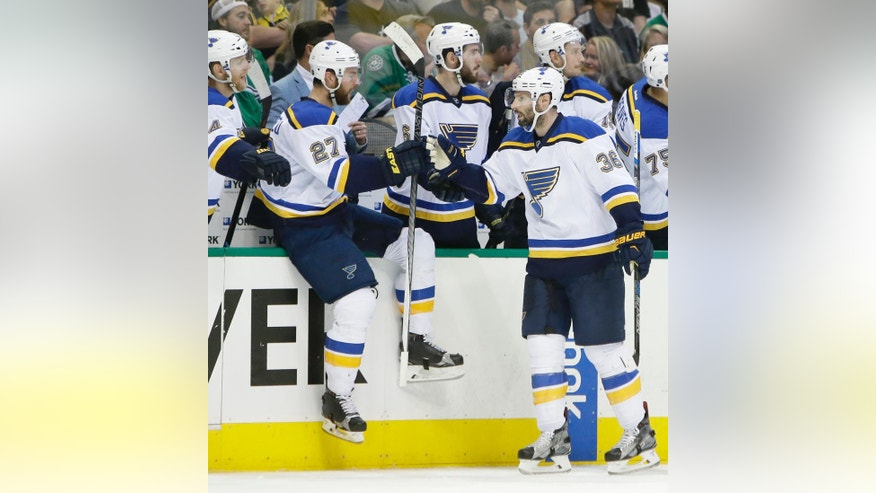 St. Louis Blues right wing Troy Brouwer (36) celebrates scoring a goal with Alex Pietrangelo (27), Carl Gunnarsson (4) and other teammates on the bench during the first period of Game 2 of the NHL hockey Stanley Cup Western Conference semifinals against the Dallas Stars, Sunday, May 1, 2016, in Dallas. (AP Photo/LM Otero)