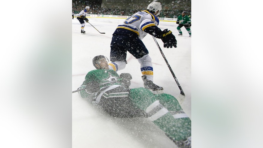 Dallas Stars center Colton Sceviour, bottom, is knocked to the ice by St. Louis Blues defenseman Alex Pietrangelo (27) during the first period in Game 1 in the second round of the NHL Stanley Cup playoffs Friday, April 29, 2016, in Dallas. (AP Photo/LM Otero)
