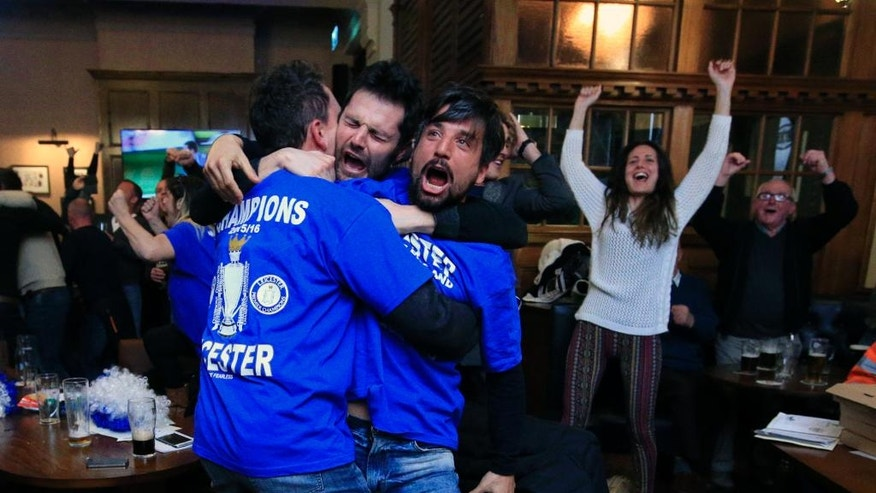 Leicester City fans react in Hogarths public house in Leicester, central England, after Chelsea's Eden Hazard scores the equalising goal against Tottenham Hotspur in their English Premier League soccer match. The match ended 2-2 resulting in Leicester City winning the Premier League, Monday May 2, 2016. (Jonathan Brady/PA via AP)  UNITED KINGDOM OUT