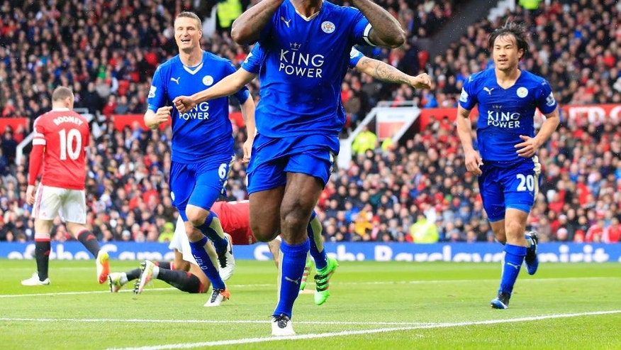 Leicester's Wes Morgan, centre, celebrates after scoring during the English Premier League soccer match between Manchester United and Leicester at Old Trafford Stadium, Manchester, England, Sunday, May 1, 2016. (AP Photo/Jon Super)