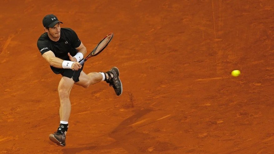 Andy Murray, from Britain, returns a ball against Radek Stepanek, from Czech Republic, during a Madrid Open tennis tournament match in Madrid, Spain, Tuesday, May 3, 2016. Murray won 7-6, 3-6 and 6-1. (AP Photo/Francisco Seco)