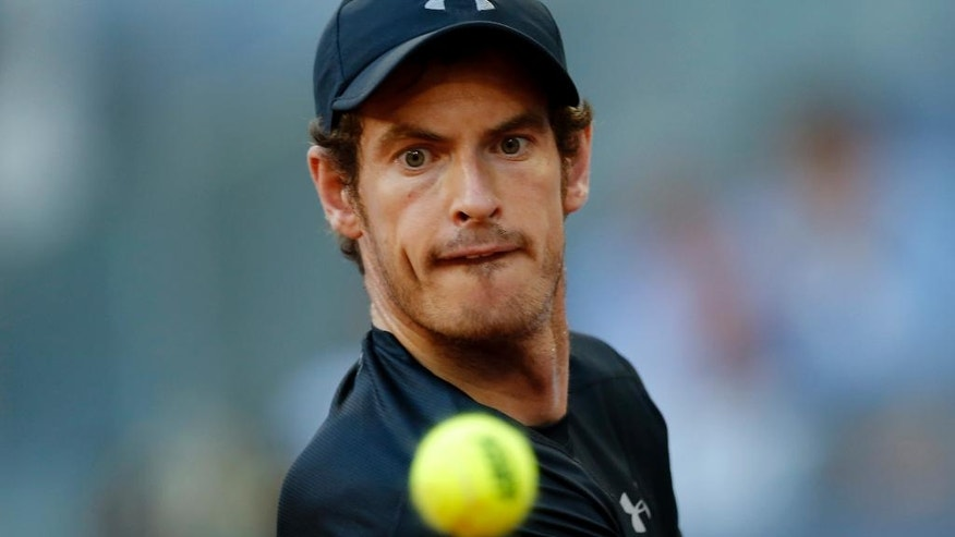 Andy Murray, from Britain, looks at the ball during his match against Radek Stepanek, from Czech Republic, during a Madrid Open tennis tournament in Madrid, Spain, Tuesday, May 3, 2016. Murray won 7-6, 3-6 and 6-1. (AP Photo/Francisco Seco)