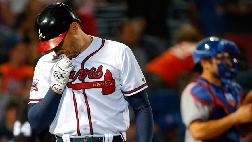 ATLANTA, GA - APRIL 22: Freddie Freeman #5 of the Atlanta Braves reacts after striking out in the fifth inning against the New York Mets at Turner Field on April 22, 2016 in Atlanta, Georgia. (Photo by Kevin C. Cox/Getty Images)