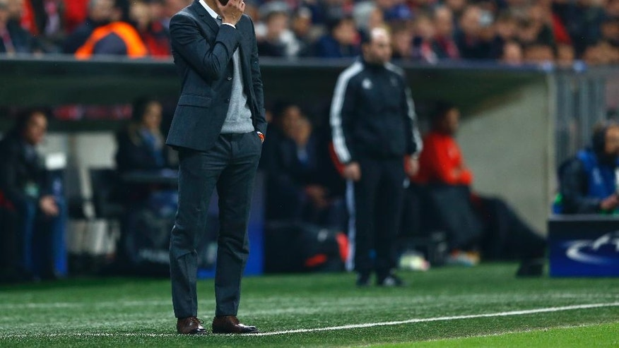 Bayern's head coach Pep Guardiola looks a the game during the Champions League second leg semifinal soccer match between Bayern Munich and Atletico de Madrid in Munich, Germany, Tuesday, May 3, 2016. (AP Photo/Matthias Schrader)