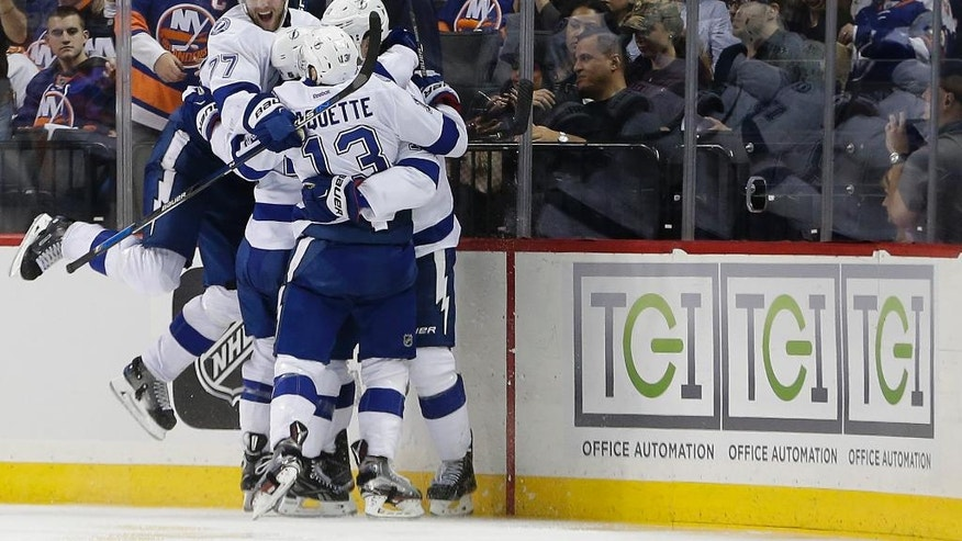 The Tampa Bay Lightning celebrate the game-winning goal by center Brian Boyle against the New York Islanders during the overtime period of Game 3 of the NHL hockey Stanley Cup Eastern Conference semifinals, Tuesday, May 3, 2016, in New York. The Lightning won 5-4. (AP Photo/Frank Franklin II)