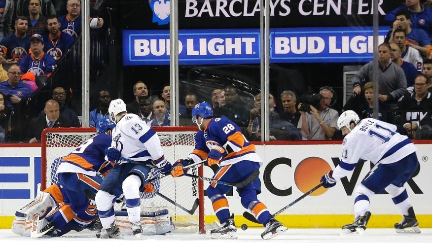 Tampa Bay Lightning center Brian Boyle (11) takes the puck off the boards and shoots to score a goal against the New York Islanders during the overtime period of Game 3 of the NHL hockey Stanley Cup Eastern Conference semifinals, Tuesday, May 3, 2016, in New York. The Lightning won 5-4. (AP Photo/Frank Franklin II)