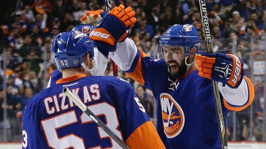 New York Islanders defenseman Nick Leddy, right, celebrates with teammates after scoring against the Tampa Bay Lightning during the second period of Game 3 of the NHL hockey Stanley Cup Eastern Conference semifinals, Tuesday, May 3, 2016, in New York. (AP Photo/Frank Franklin II)