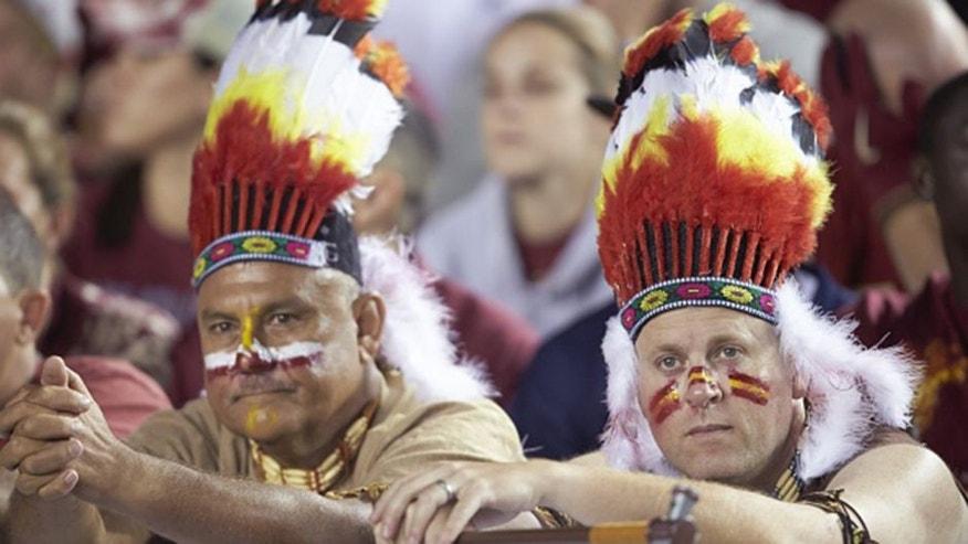 College Football: Florida State fans with face paint and feather headdress in school colors in stands during game vs Notre Dame at Doak Campbell Stadium. Tallahassee, FL 10/18/2014 CREDIT: Jason Parkhurst (Photo by Jason Parkhurst /Sports Illustrated/Getty Images) (Set Number: X158843 TK1 )
