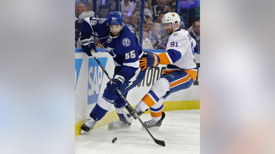 Tampa Bay Lightning defenseman Braydon Coburn (55) sidesteps New York Islanders center John Tavares (91) during the third period of Game 2 of the NHL hockey Stanley Cup Eastern Conference semifinals Saturday, April 30, 2016, in Tampa, Fla. the Lightning won the game 4-1. (AP Photo/Chris O'Meara)