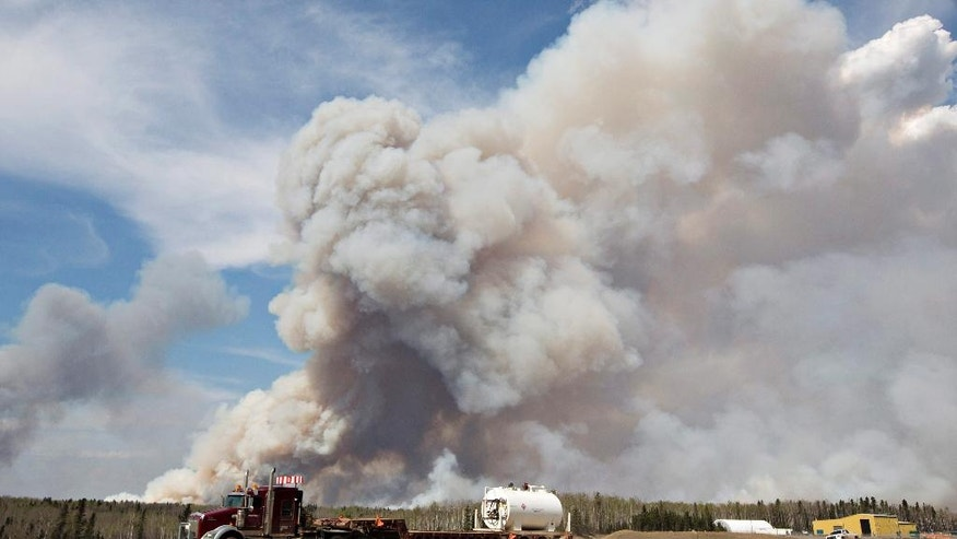 A wildfire rages through Fort McMurray, Alberta, on Wednesday, May 4, 2016. The raging wildfire emptied Canada's main oil sands city, destroying entire neighborhoods of Fort McMurray, where officials warned Wednesday that all efforts to suppress the fire have failed.  (Jason Franson /The Canadian Press via AP) MANDATORY CREDIT