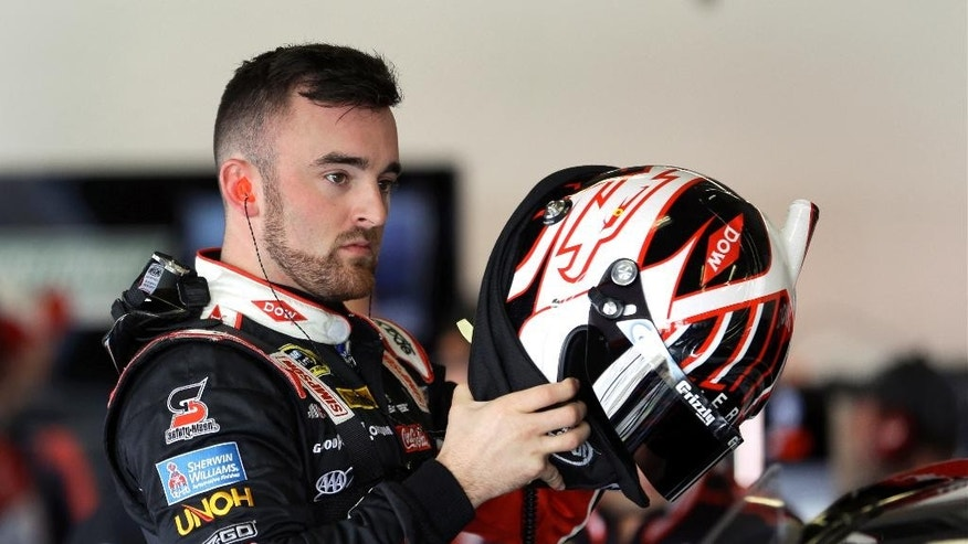 FILE - In this Feb. 13, 2016, file photo, Austin Dillon puts on his helmet in his garage during a practice session for the NASCAR Daytona 500 auto race at Daytona International Speedway in Daytona Beach, Fla. Dillon survived the wrecks at Talladega last weekend to post a career-best third-place finish. He's 10th in the standings and having the best season of his three-year career. (AP Photo/John Raoux, File)