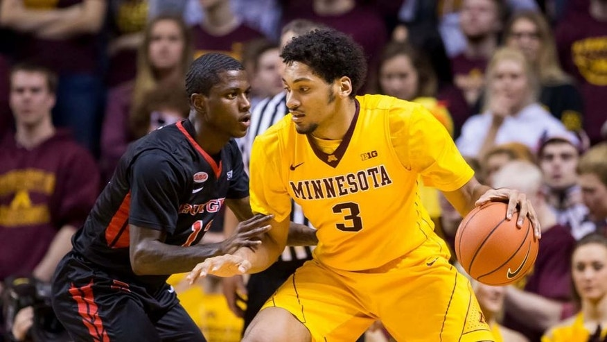 Feb 23, 2016; Minneapolis, MN, USA; Minnesota Gophers forward Jordan Murphy (3) dribbles in the first half against the Rutgers Scarlet Knights guard Khalil Batie (13) at Williams Arena. Mandatory Credit: Brad Rempel-USA TODAY Sports