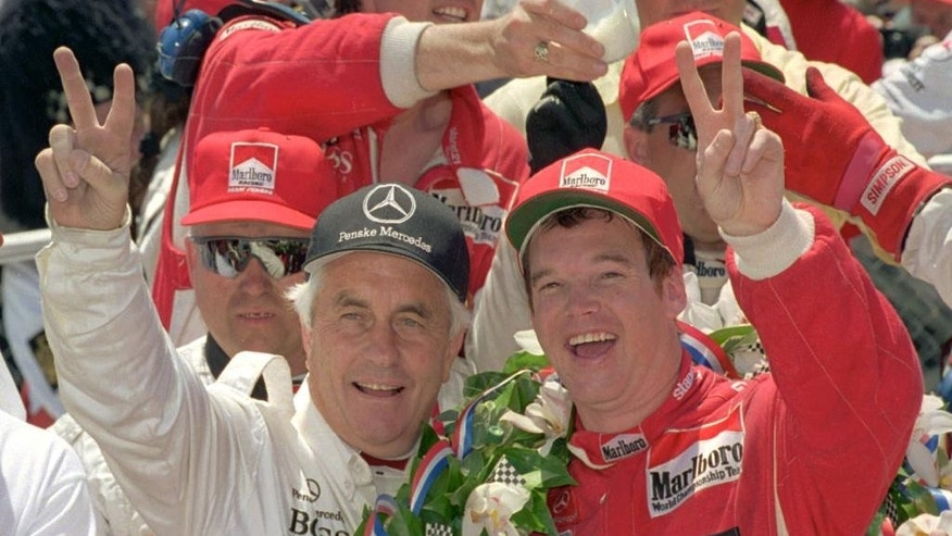 FILE - In this May 29, 1994 file photo, Indianapolis 500 winner Al Unser Jr., right, celebrates with car owner Roger Penske after winning the 78th running of the race at Indianapolis Motor Speedway. (AP Photo/Al Behrman, File)