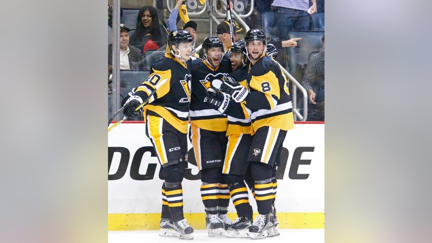 Pittsburgh Penguins, left to right. Oskar Sundqvist (40), Matt Cullen (7), Trevor Daley (6) and Brian Dumoulin (8) celebrate Cullen's goal during the second period of Game 4 in an NHL hockey Stanley Cup Eastern Conference semifinals in Pittsburgh, Wednesday, May 4, 2016. (AP Photo/Gene J. Puskar)