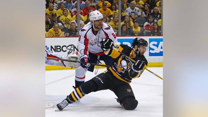 Washington Capitals Alex Ovechkin (8) checks Pittsburgh Penguins Nick Bonino (13) during the second period of Game 4 in an NHL hockey Stanley Cup Eastern Conference semifinals in Pittsburgh, Wednesday, May 4, 2016. (AP Photo/Gene J. Puskar)