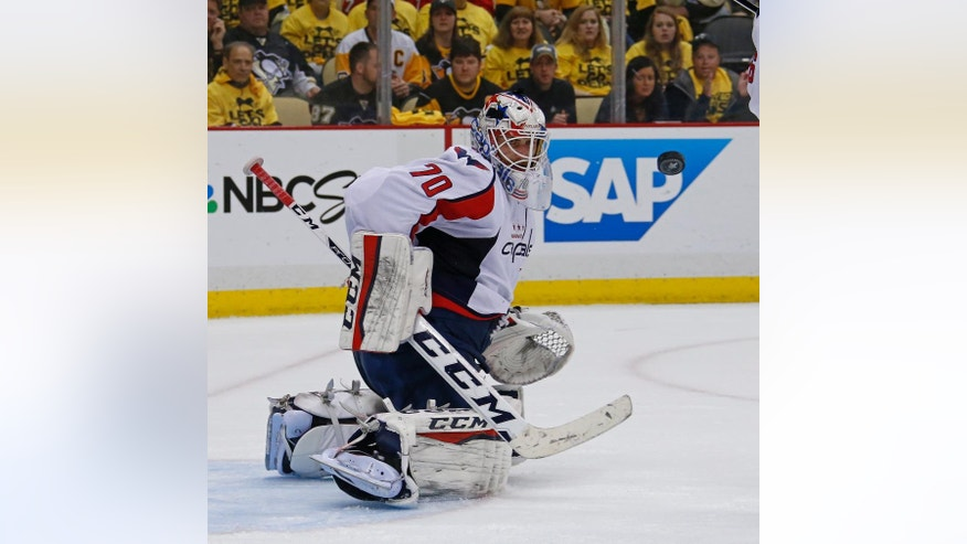 Washington Capitals goalie Braden Holtby (70) gets in front of a shot during the second period of Game 4 against the Pittsburgh Penguins in an NHL hockey Stanley Cup Eastern Conference semifinals in Pittsburgh, Wednesday, May 4, 2016. (AP Photo/Gene J. Puskar)