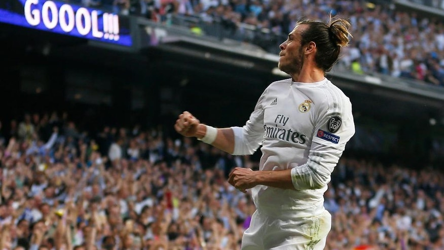 Real Madrid's Gareth Bale celebrates after scoring the opening goal during the Champions League semifinal second leg soccer match between Real Madrid and Manchester City at the Santiago Bernabeu stadium in Madrid, Wednesday May 4, 2016. (AP Photo/Francisco Seco)
