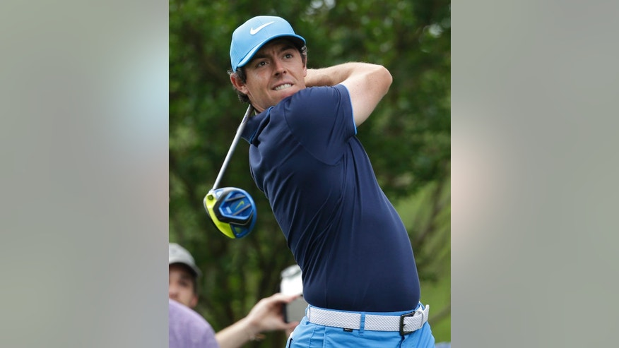 Rory McIlroy watches his tee shot on the third hole during the pro-am of the Wells Fargo Championship golf tournament at Quail Hollow Club in Charlotte, N.C., Wednesday, May 4, 2016. (AP Photo/Chuck Burton)