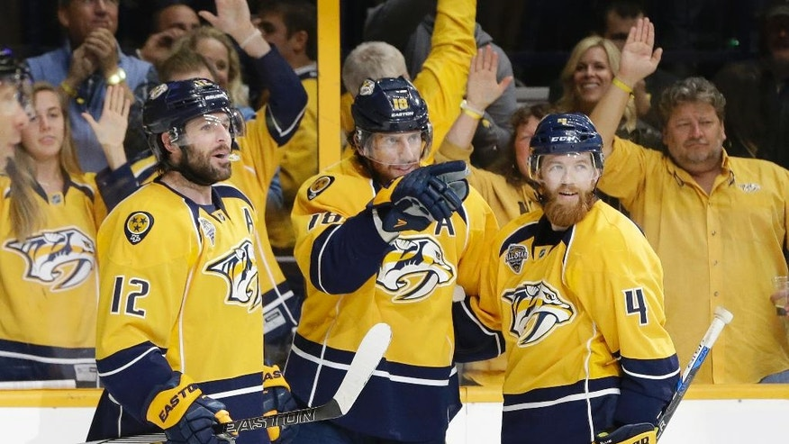 Nashville Predators left wing James Neal (18) celebrates with Mike Fisher (12) and Ryan Ellis (4) after Neal scored a goal against the San Jose Sharks during the second period in Game 3 of an NHL hockey Stanley Cup Western Conference semifinal playoff series Tuesday, May 3, 2016, in Nashville, Tenn. (AP Photo/Mark Humphrey)
