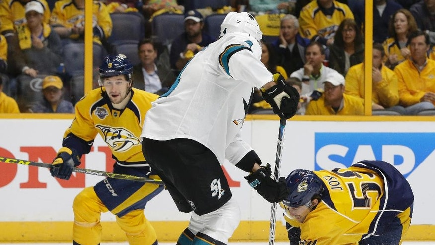 Nashville Predators defenseman Roman Josi (59), of Switzerland, falls as he takes a shot in front of San Jose Sharks defenseman Brenden Dillon (4) during the second period in Game 3 of an NHL hockey Stanley Cup Western Conference semifinal playoff series Tuesday, May 3, 2016, in Nashville, Tenn. (AP Photo/Mark Humphrey)