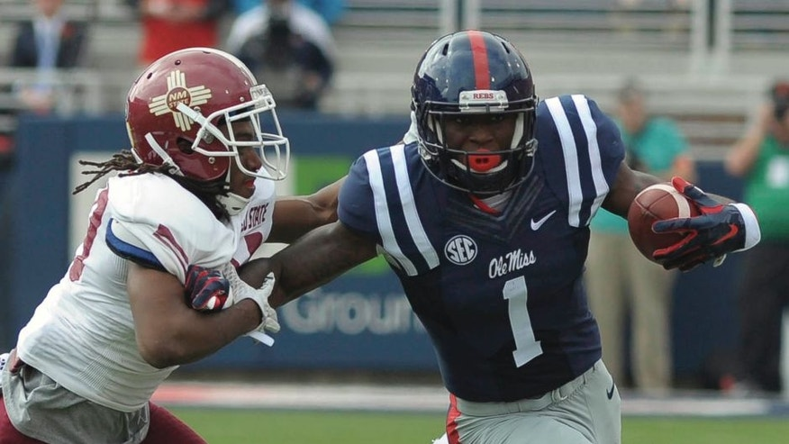 Oct 10, 2015; Oxford, MS, USA; Mississippi Rebels wide receiver Laquon Treadwell (1) carries the ball against New Mexico State Aggies defensive back Lewis Hill (29) during the game at Vaught-Hemingway Stadium. Mandatory Credit: Justin Ford-USA TODAY Sports
