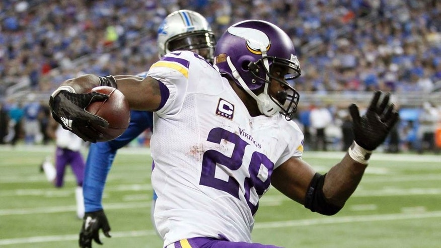 Minnesota Vikings running back Adrian Peterson breaks downfield for a 75-yard run during the second half against the Detroit Lions on Sunday, Oct. 25, 2015, in Detroit.