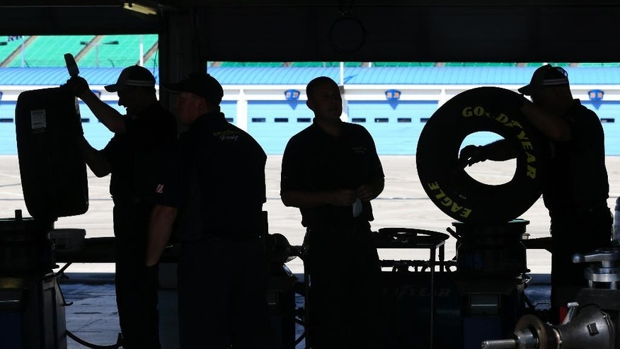 Workers mount racing tires in preparation for NASCAR auto races this weekend at Kansas Speedway in Kansas City, Kan., Thursday, May 5, 2016. (AP Photo/Orlin Wagner)