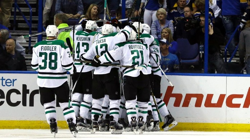 Teammates congratulate Dallas Stars' Cody Eakin on his game-winning goal during the overtime of Game 4 of the NHL hockey Stanley Cup Western Conference semifinals against the St. Louis Blues, Thursday, May 5, 2016, in St. Louis. The Stars won 3-2. (AP Photo/Jeff Roberson)